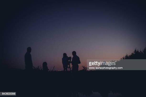 family star gazing with telescope - 天文学 ストックフォトと画像