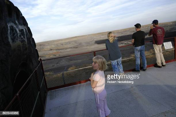 Family stops at a mine overview north of Gillette, Wyoming, May 5, 2004. Wyoming coal is transported by rail east to St. Louis, Detroit, Chicago and...