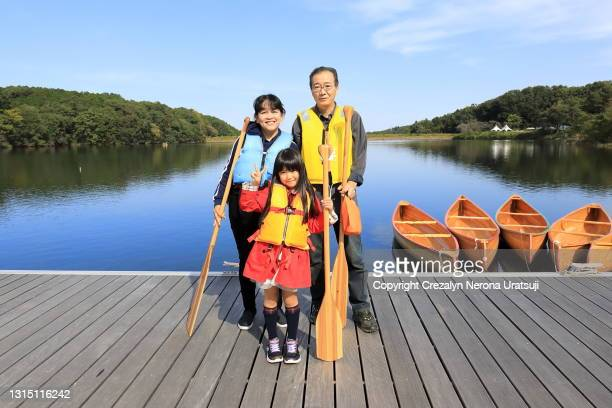 family strike a pose with canoe - saitama prefecture stock pictures, royalty-free photos & images