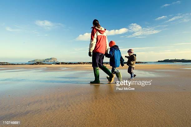 Family stroll on beach