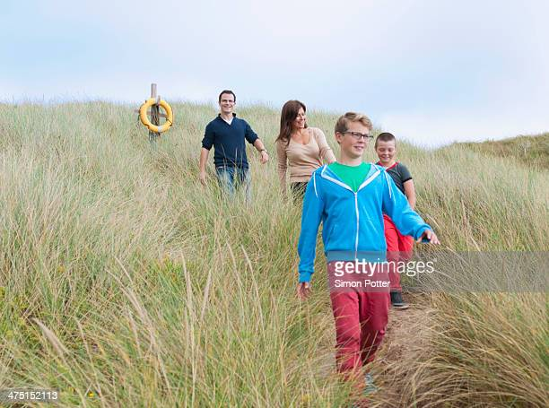 Family strolling coastal path