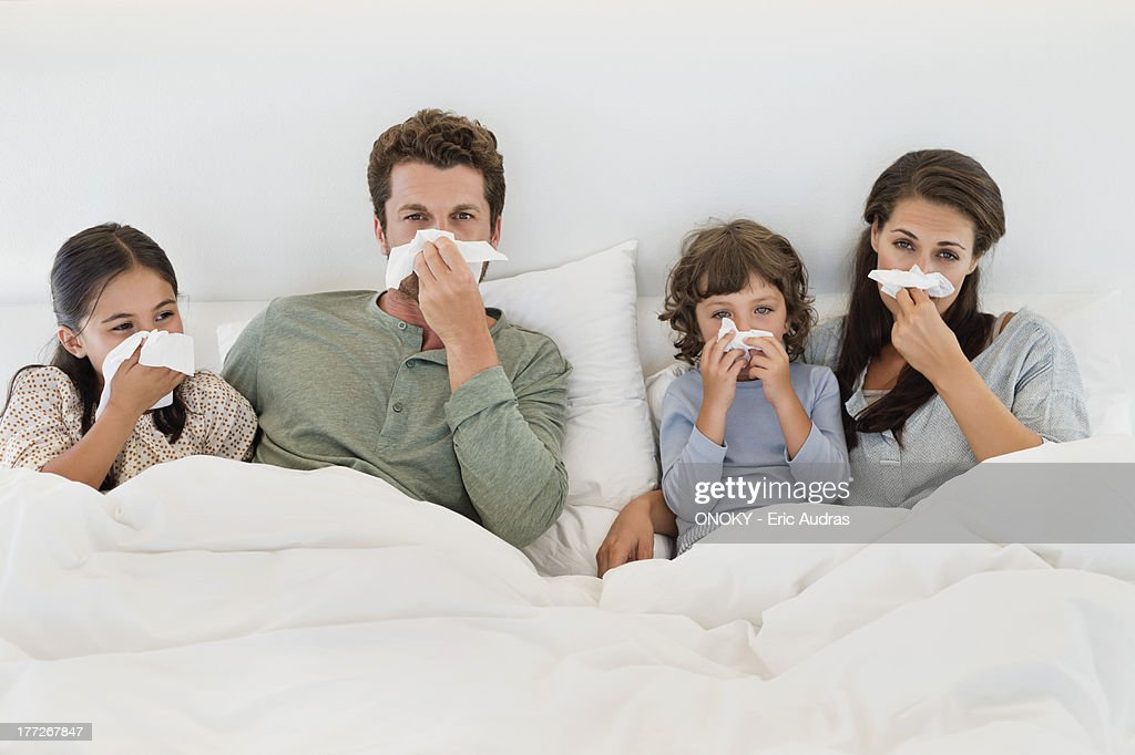 Family suffering from cold : Stock Photo