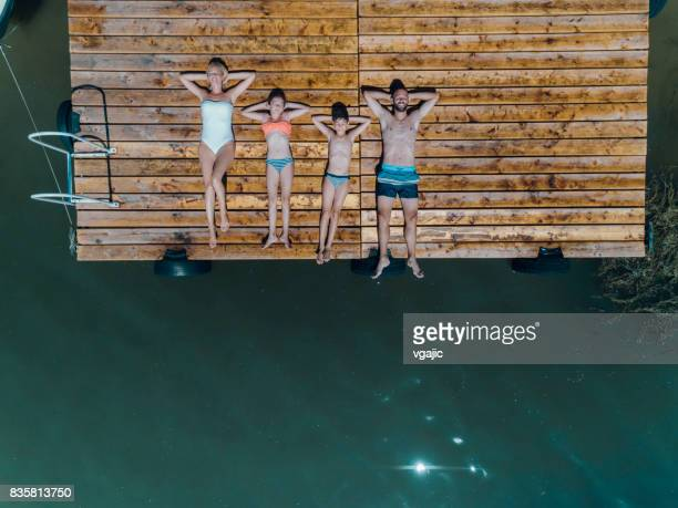 family summer fun - girls sunbathing stock photos and pictures