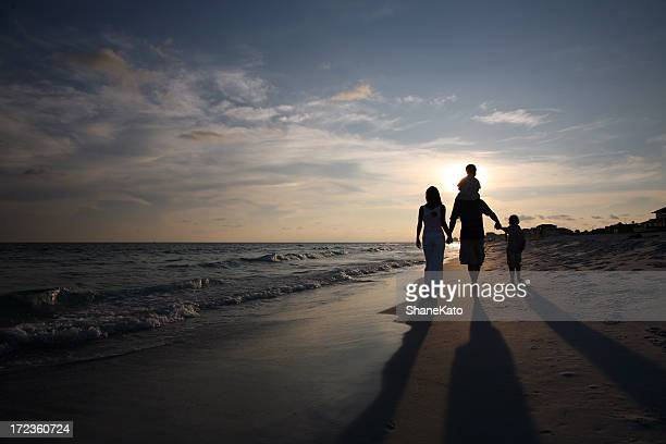 family sunset walk - gulf coast states stockfoto's en -beelden