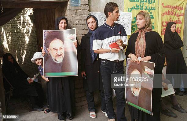 Family, supporters of president Mohammad Khatami, gather on their doorstep, holding his pictures, to wait for him to turn up at Jamaran mosque in...