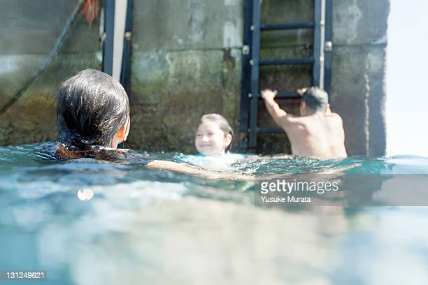 family swimming in the sea - sea swimming stock pictures, royalty-free photos & images