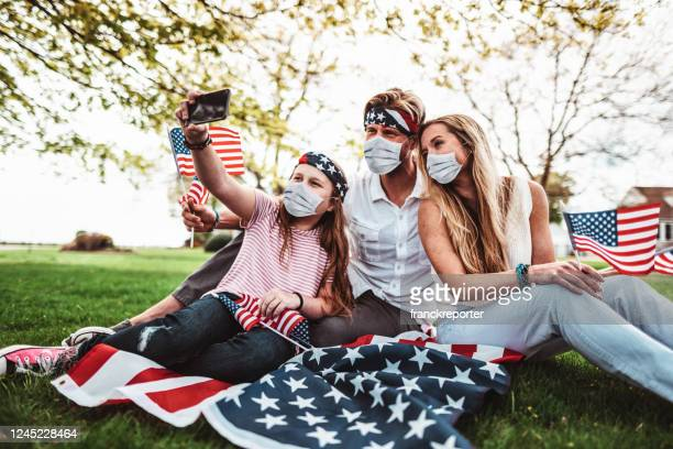 family take a selfie during the us holiday - fourth of july stock pictures, royalty-free photos & images