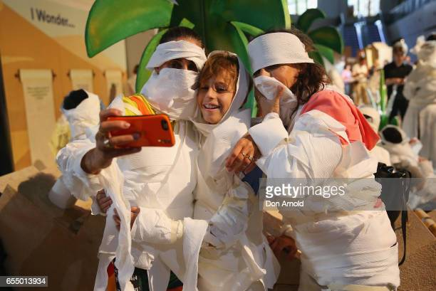 A family takes a selfie at Powerhouse Museum on March 19 2017 in Sydney Australia A total of 846 people wrapped themselves in toilet paper to set the...