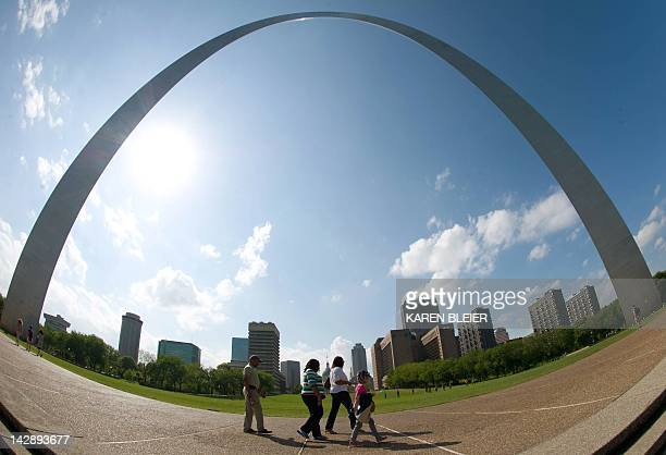 A family takes a stroll under the Gateway Arch April 14 2012 in St Louis Missouri on a sunny Sunday afternoon AFP PHOTO / Karen BLEIER