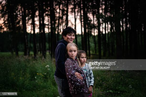 Family takes a walk in a forest near the village of Yermolino, some 50 km from Moscow, on July 18, 2020. - Russians stuck at country homes due to...
