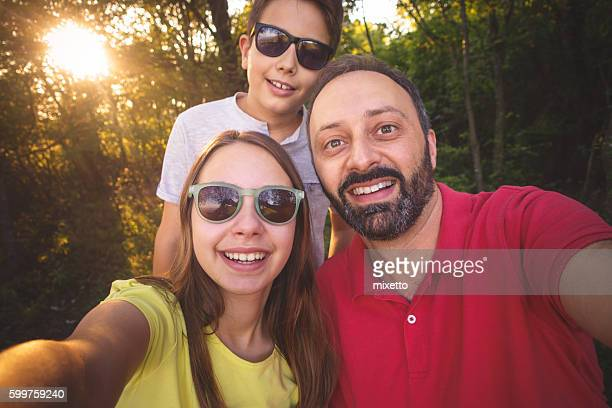 Family takes selfie in nature
