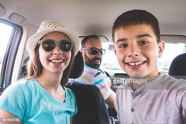 Family takes selfie in the car