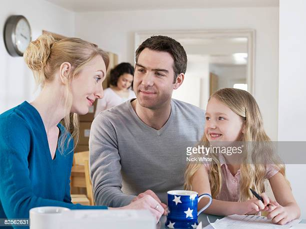 Family taking a break at kitchen table