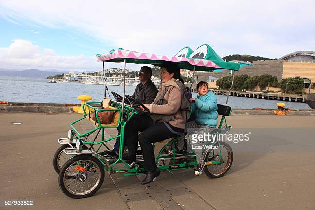 Family taking a discovery tour from Oriental Bay to Kumutoto on an Enormous Crocodile quadricycle on Wellington's waterfront Wellington, South...