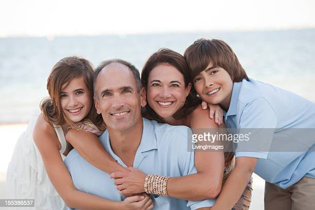 A family taking a family photo on a beach