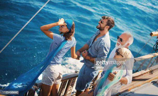 family taking a sailing cruise. - tourboat stock pictures, royalty-free photos & images