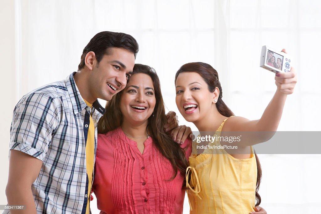 Family taking a self portrait : Stock Photo