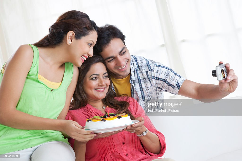 Family taking a self portrait : Stock Photo