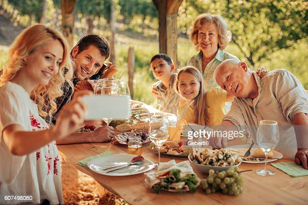 Family taking a selfie at a picnic