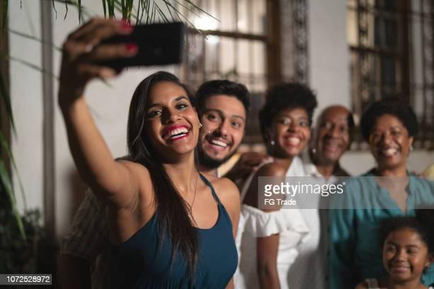 family taking a selfie at home - cultura brasileira imagens e fotografias de stock