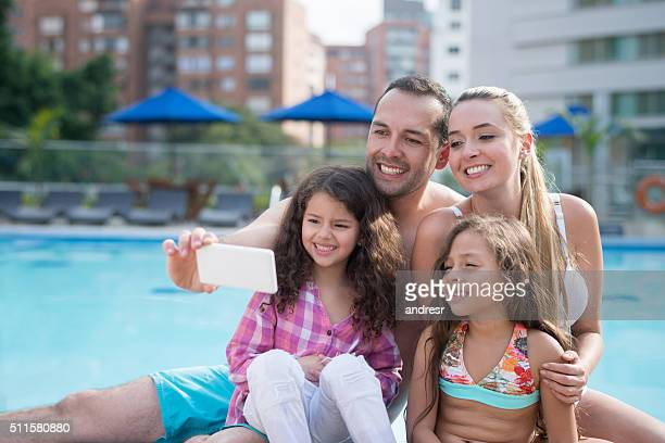 Family taking a selfie by the pool
