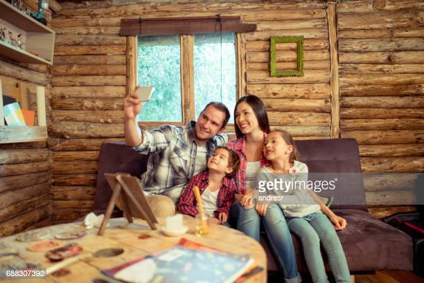 Family taking a selfie in their beautiful cottage