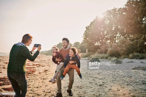Family taking a selfie on the beach