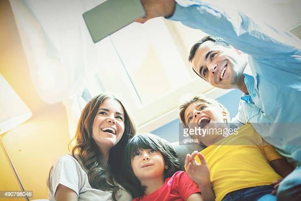 Family taking a selfie.