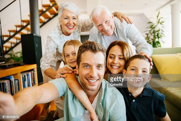family taking a selfie - family photos stock photos and pictures
