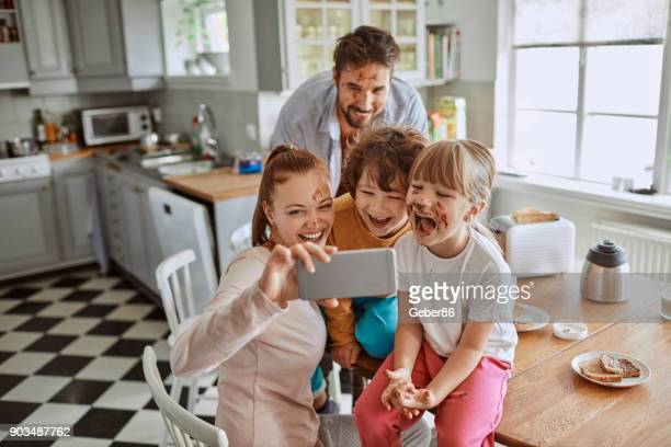 family taking a selfie - nutella stock pictures, royalty-free photos & images
