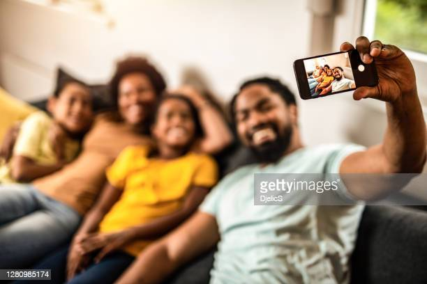 family taking a selfie together. - photo messaging stock pictures, royalty-free photos & images