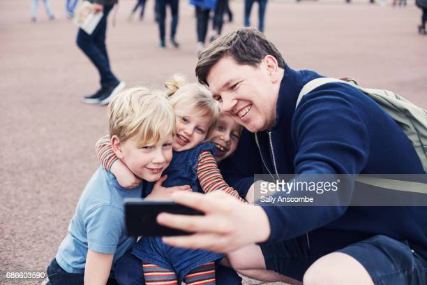 Family taking a selfie together