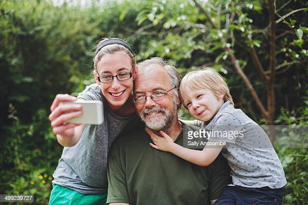 Family taking a selfie with a smart phone