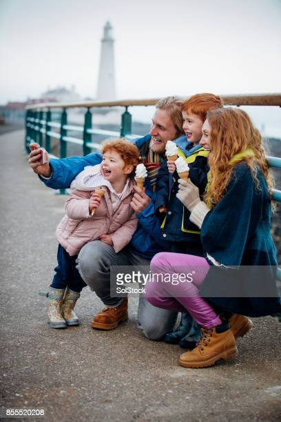 family taking a selfie with their ice-cream cones on the coast - northeastern england stock photos and pictures