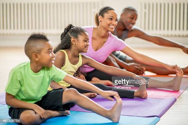 Family Taking a Yoga Class