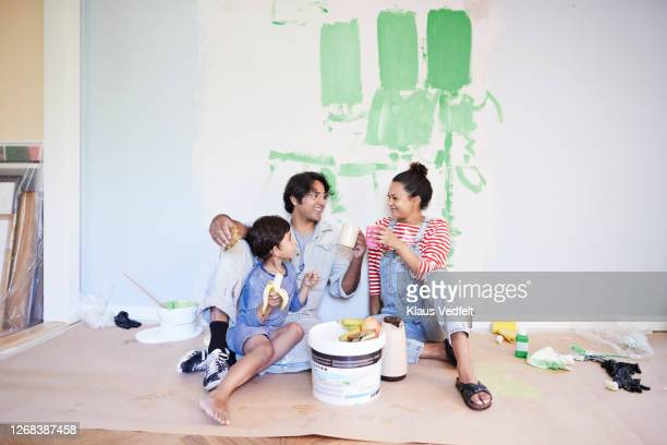 family taking break while renovating home - pregnant coffee stock pictures, royalty-free photos & images