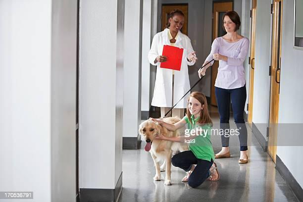 Family taking pet to the vet