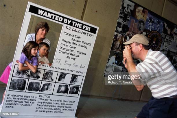 Family Taking Pictures on FBI Tour