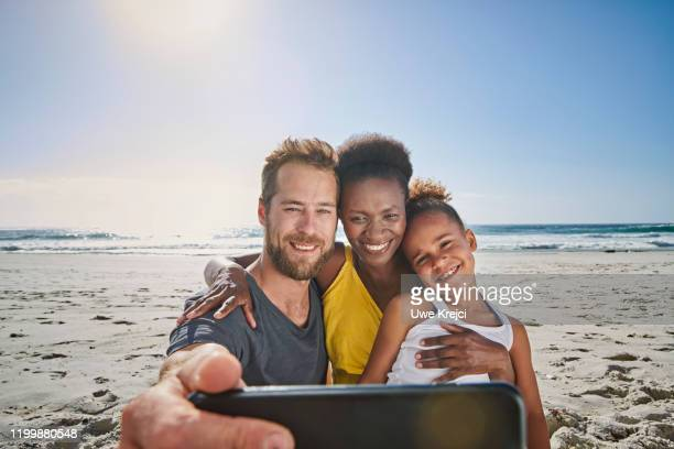 family taking self portrait on beach - south africa stock pictures, royalty-free photos & images