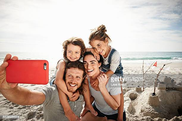 Family taking self portrait on beach