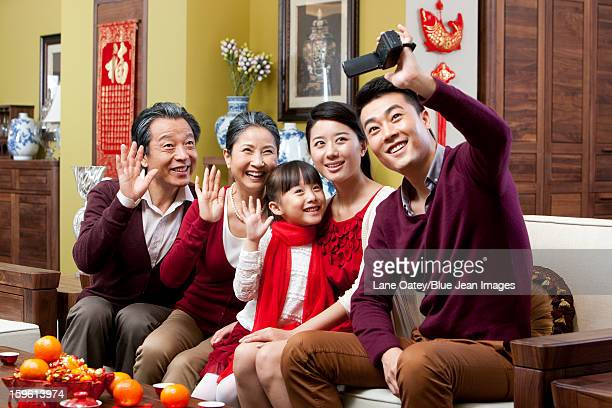 Family taking self portrait shots during Chinese New Year