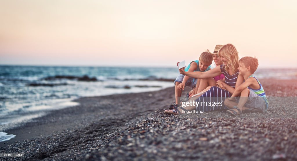 Family taking selfie on a beach in the evening : Stock Photo