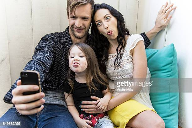 Family taking selfie with cell phone
