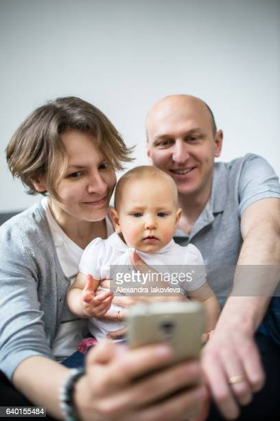 Family taking selfies at home