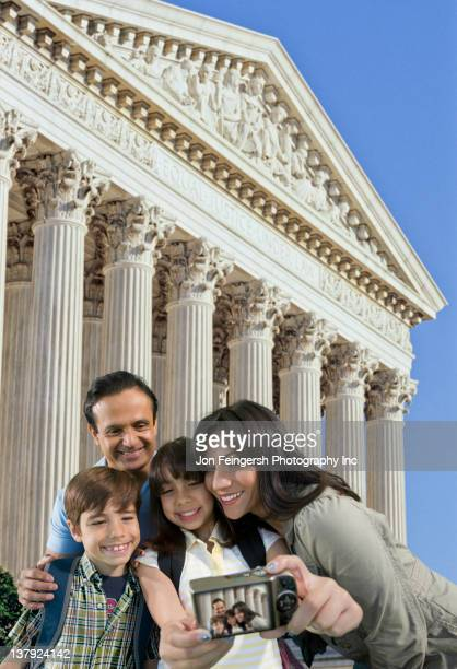 Family taking self-portrait while sightseeing