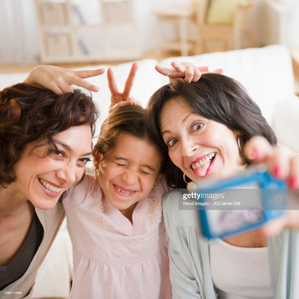 Family taking self-portrait with digital camera : Stock Photo