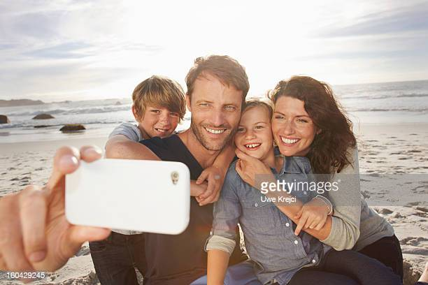 Family taking self-portrait with smart phone