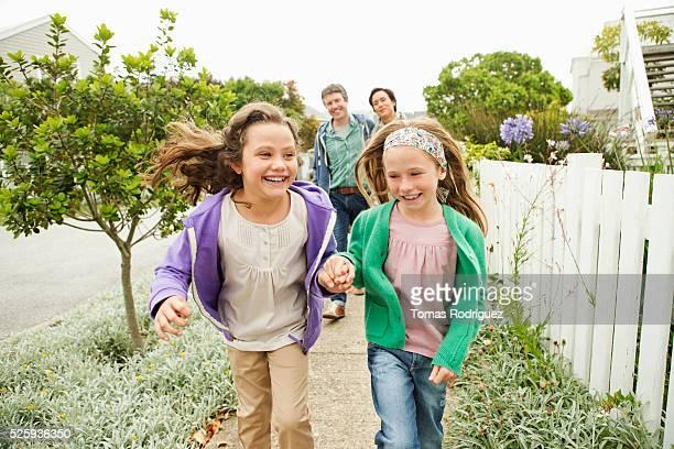 Family taking walk, girls (6-7), (8-9)