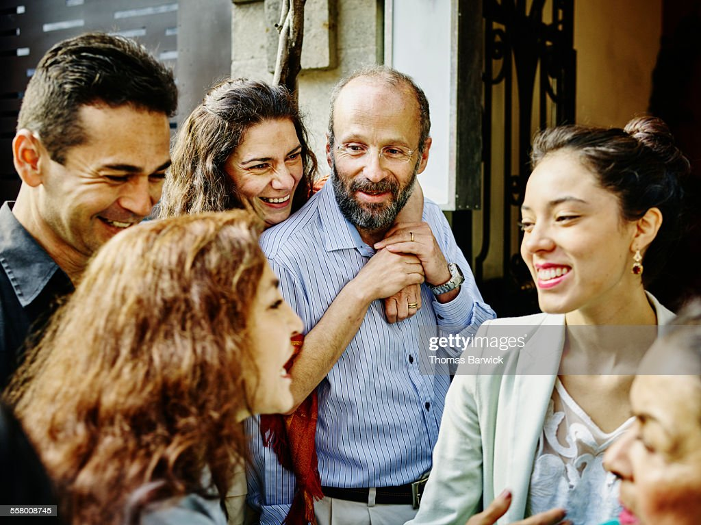 Family talking and laughing during party : Stock Photo