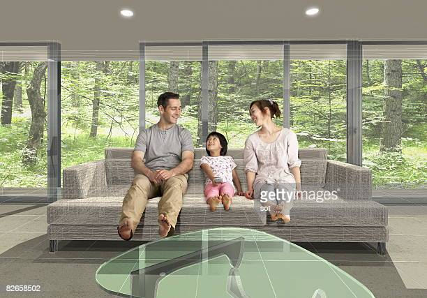 Family talking on the sofa, smiling